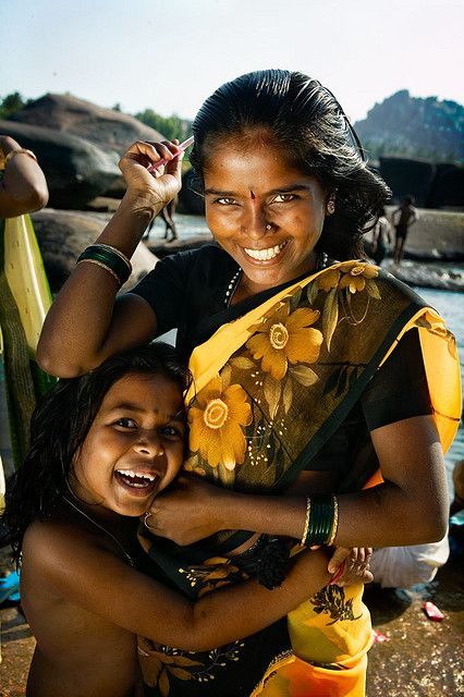Mother and daughter combing their hair at a ghat in Kerala, India. by phitar.