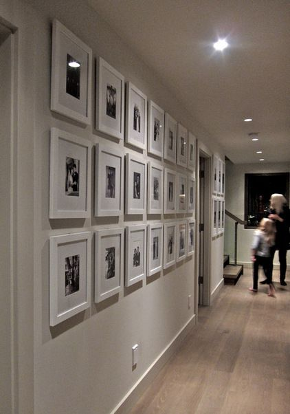 Black and white photos in white photo frames for family gallery wall or travel photo wall (Gaile Guevara)
