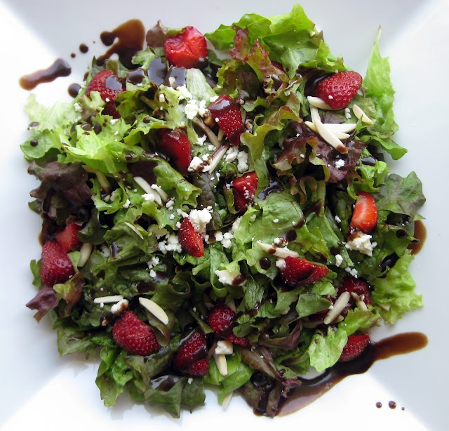 leafy salad with strawberry, feta and balsamic vinegar