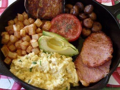 Skillet breakfast - scrambled eggs with chives, peameal bacon, sauteed ...