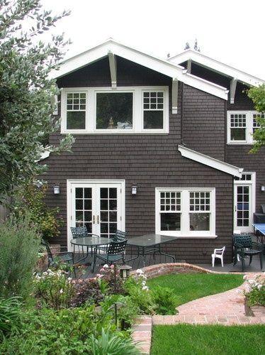 dark cedar siding and white trim exterior home makeover