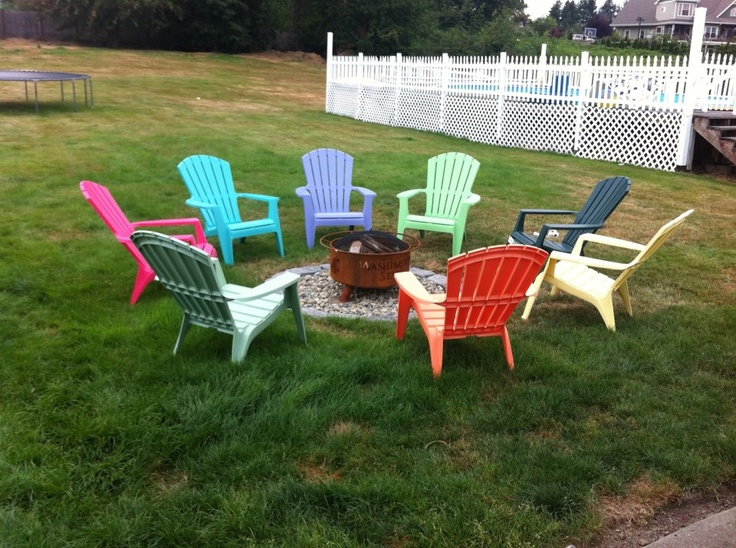 Backyard patio firepit ideas - Adirondack Chairs Eight Different Colors All Around The New Fire Pit