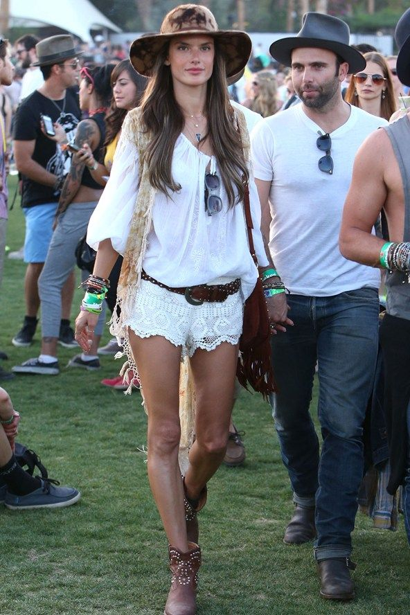 Be part of our journey... www.facebook.com/tanandbrown  Coachella! Alessandra Ambrisio in white lace shorts, a peasant blouse and wide-rimmed hat.  Photo by Wenn  Source: http://www.vogue.co.uk/spy/celebrity-photos/2013/4/15/coachella-2013/gallery/962111