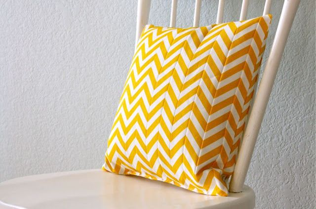 This is too complicated for me as far as sewing goes- but here you go! Chevron pillow made from striped fabric