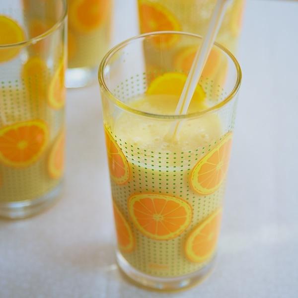 Fruit smoothie with frozen mango, mango Greek yogurt, and a dash of ...