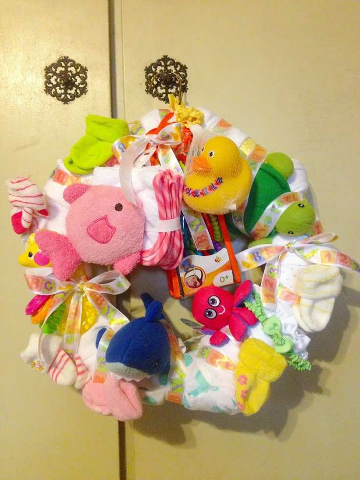 homemade baby shower gift made with a simple hanger safety pins