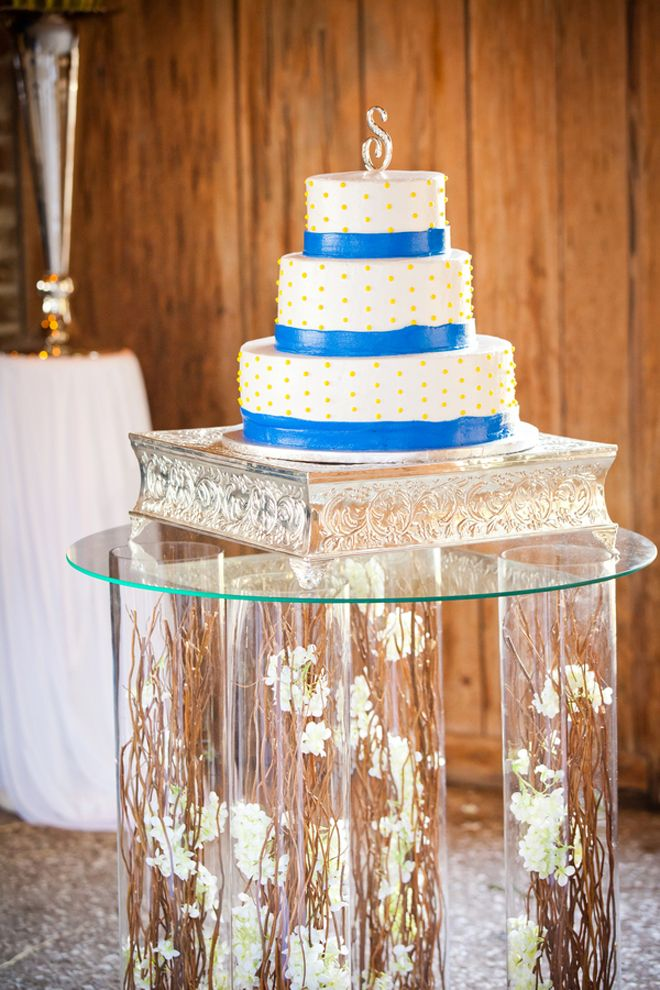 Cake table on twig and flower filled vases as pedestals. Photo: Corey ...