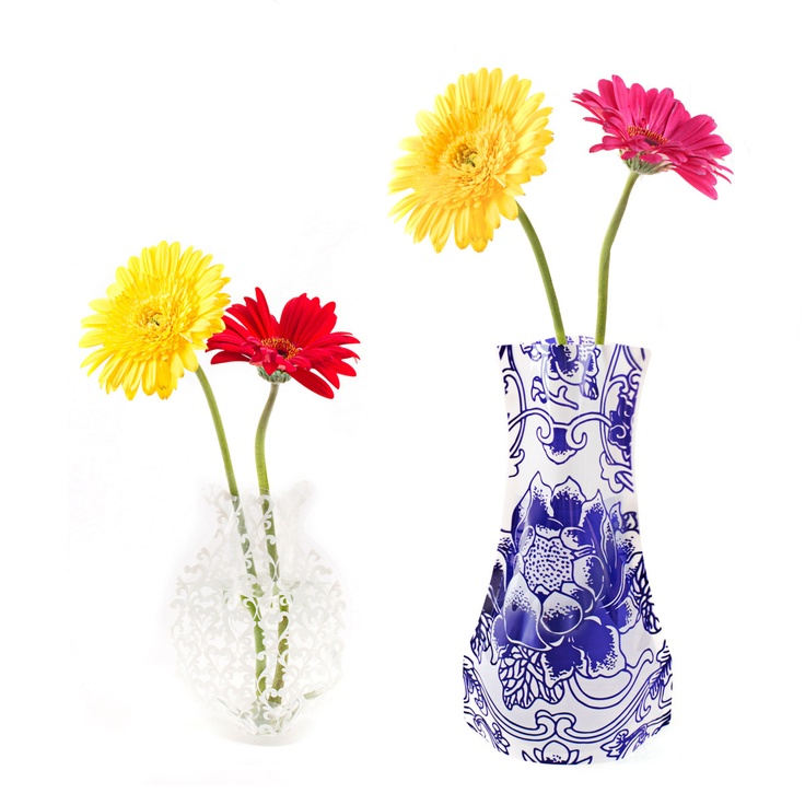 """Score! Your boyfriend brought home flowers """"just because."""" But now you have to rummage through the cabinet under your sink where vases go to die. Replace those bulky containers with Clark and Wellington's space saving Collapsible Vase. These colorful flower holders arrive flat—simply fill them with hot water, hand-form the vase into desired shape, empty and refill with cold water. The moldable plastic will fit your flowers like a glove."""