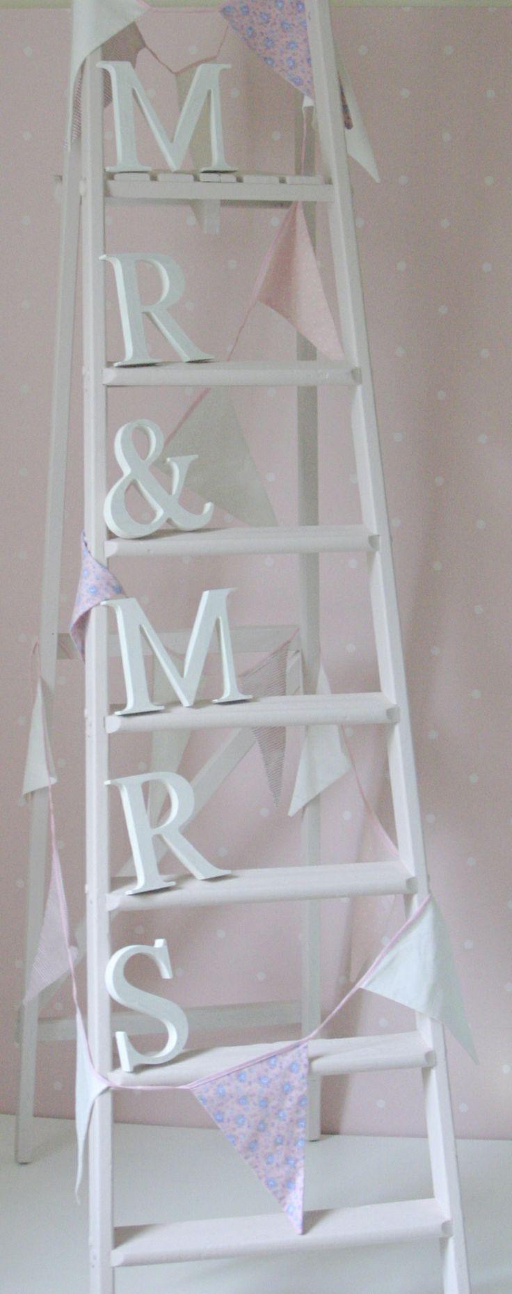 neat wedding decoration vintage ladders pinterest. Black Bedroom Furniture Sets. Home Design Ideas