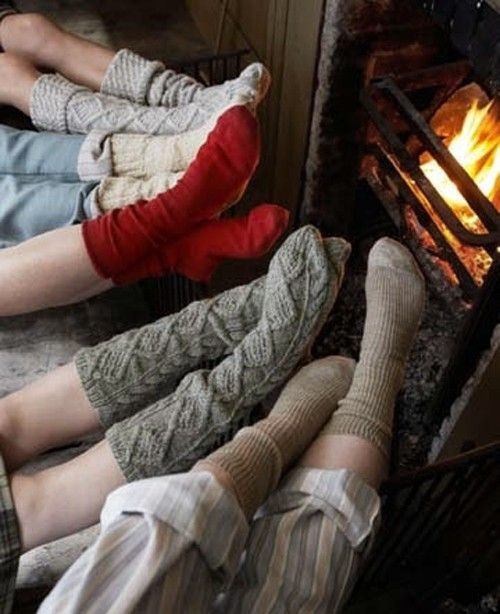 unfreezing your feet at the fire in your winter socks