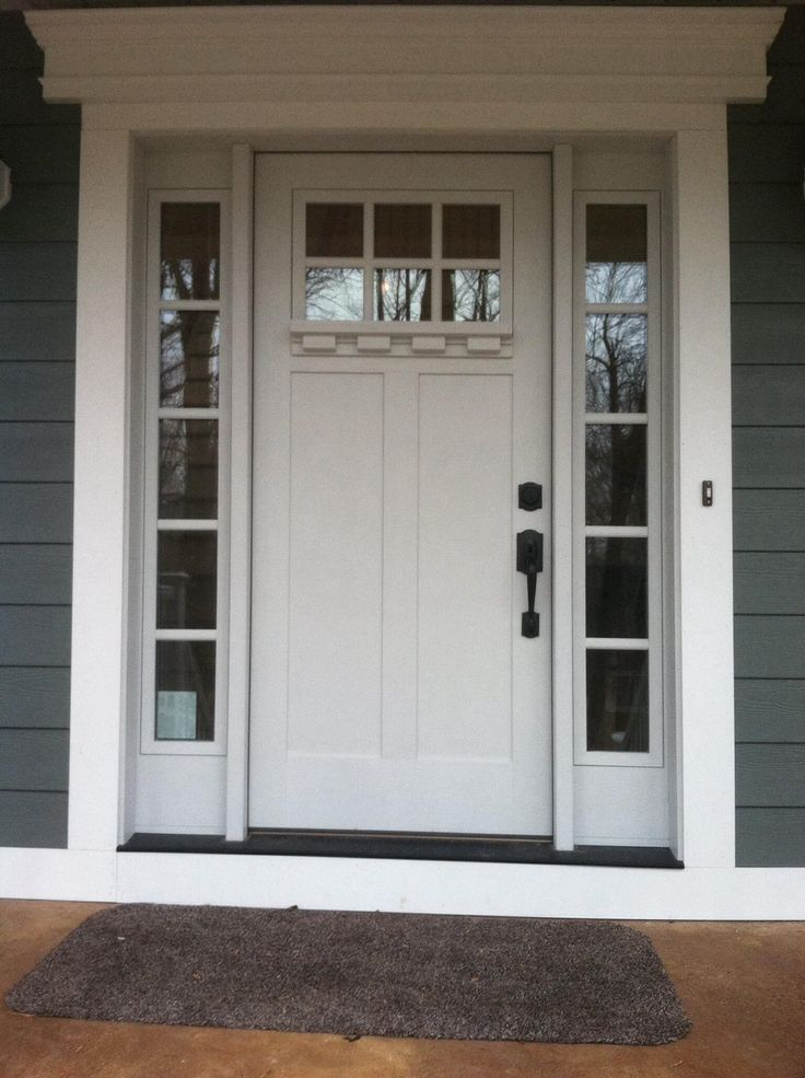 front door factory-painted in white with Clarion windows, sidelights
