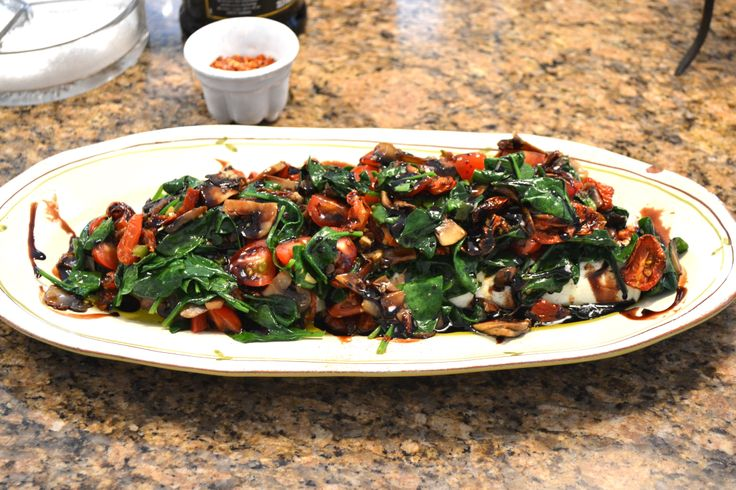 Warmed goat cheese with spinach, tomatoes and a balsamic drizzle. Easy ...