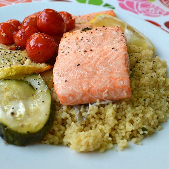 Fresh salmon baked in a lemon oregano and basil sauce served with ...