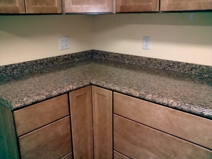 Countertop uppers and lower cabinets installed maple w macaroon