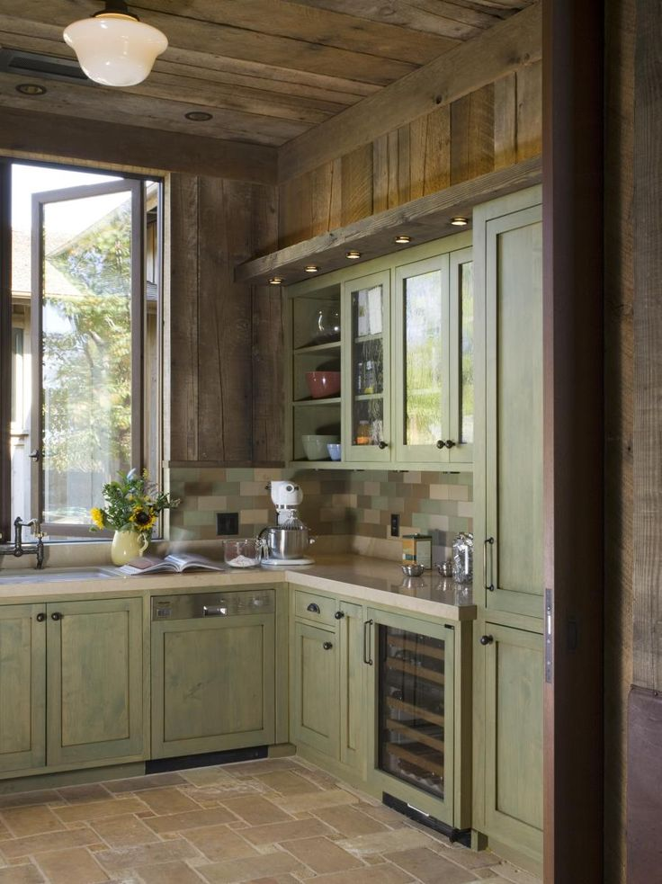 A rustic wine country retreat painted wood cabinets for Kitchen cabinets rustic
