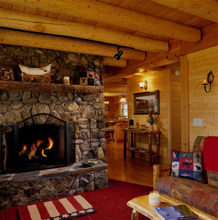 Log cabin with beautiful stone fireplace dream for Log cabin fireplaces pictures