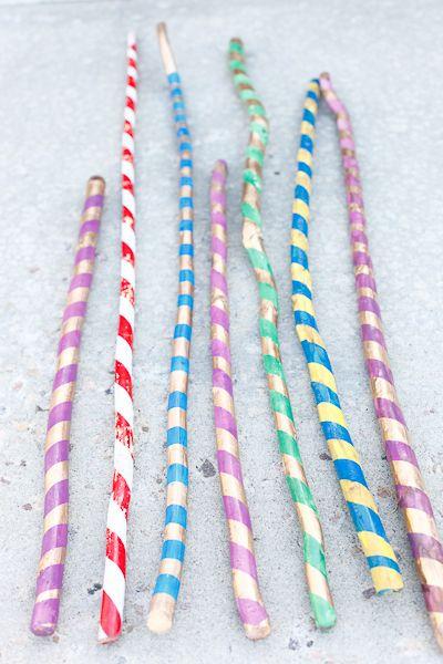 Walking Sticks on thecraftingchicks.com #walkingsticks #summerfun #spraypaint