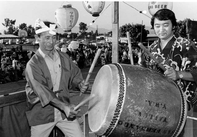 Japanese Obon Festival,  sponsored by the San Fernando Valley Buddhist Church, August 2, 1981. Kaz Hombo and Paul Jonkuchi play for Japanese dancers. Robert and Betty Franklin Collection. San Fernando Valley History Digital Library.