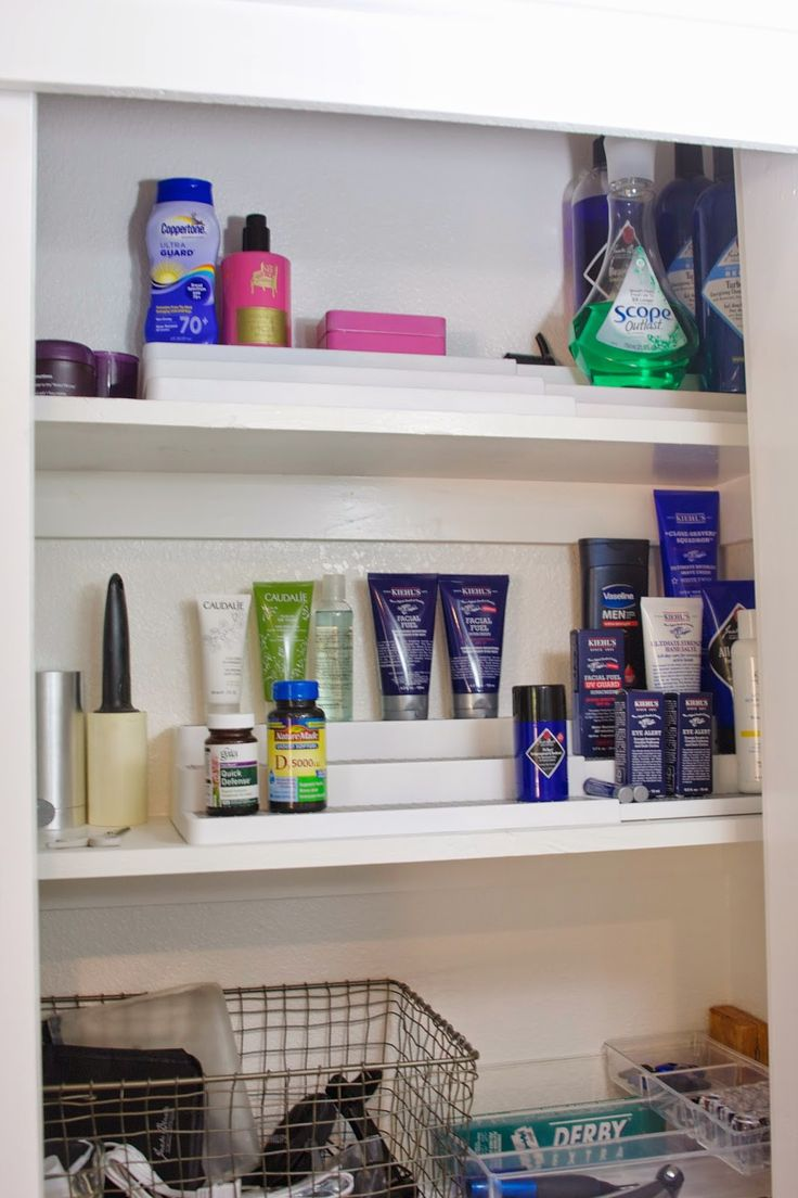 Use tiered spice racks to organize your bathroom supplies.