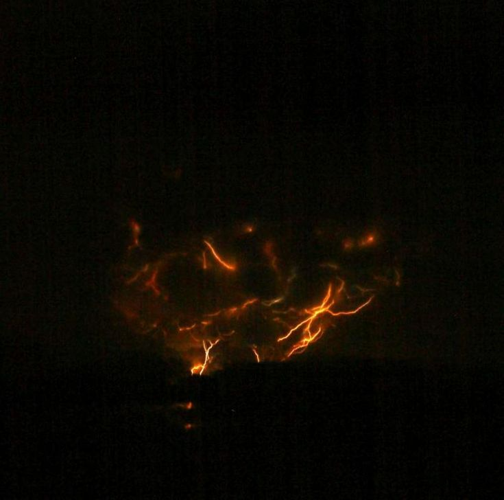 Photograph of lightning from Alaska's Mt. Redoubt's 1:20 am March 28 eruption, courtesy of Bretwood Higman.