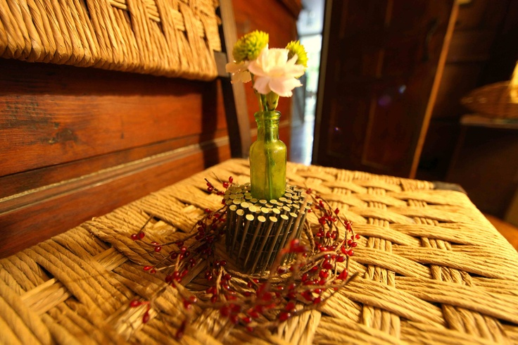 A leftover roll of nails makes an interesting flower vase.
