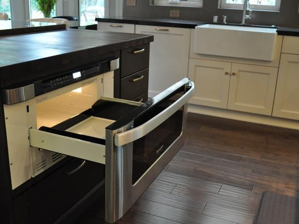 pull out microwave drawer in warm brown kitchen island