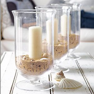 Easy! Glass jar with sand at bottom and shells with candle