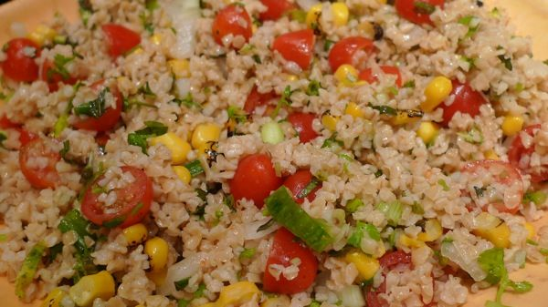 Bulgur Wheat Salad with Tomatoes and Roasted Corn served with Roasted ...