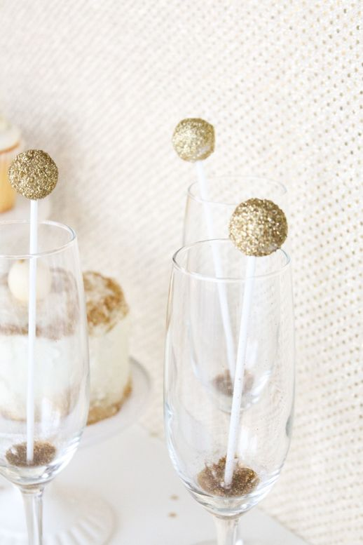 Cover Styrofoam balls with Tacky glue and then roll them in glitter. Stick them to the ends of plastic drink stirrers for a simple, custom addition. You can even add name flags to them!