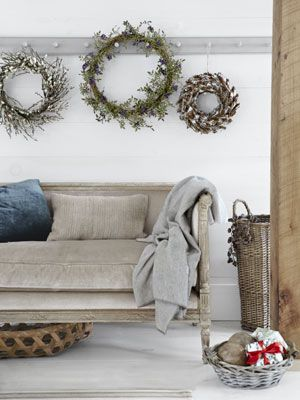 Branch out (literally) beyond evergreen varieties and use twigs, berries, and pine cones for your next wreath.
