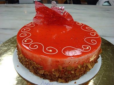 ... and layered with Grand Marnier cream, topped with a Strawberry Glaze
