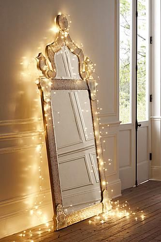 Starry light string on a pretty mirror - love this idea!
