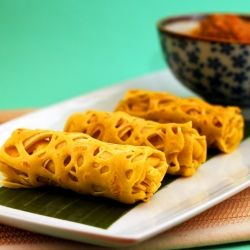 Roti jala (Malaysian net crepes), served with chicken and potato curry