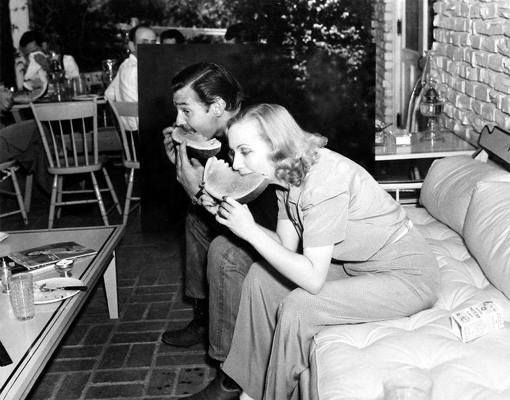 Carole Lombard & Clark Gable eating watermelon