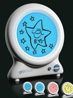 """""""Stay in bed until you see the sun!""""   Parents set the clock to display a cheerful smiley sun at progressively later times of morning, training the child to get up only once they """"see the sun"""""""