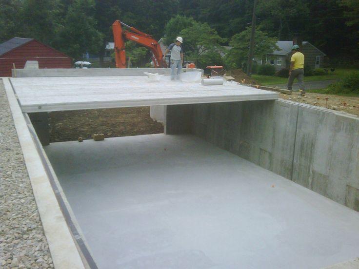 Pre cast concrete garage floor placement foundations for Precast concrete basement walls cost