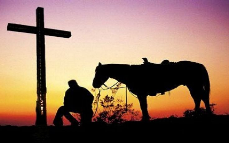 Cowboy Kneeling Before The Cross At Sunset Cowboys Plus