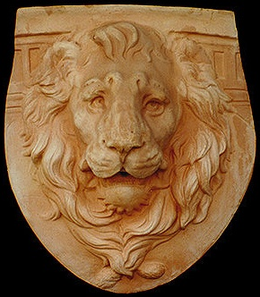 Terracotta lion's head, from Impruneta, Tuscany...can be hung but is pre-drilled to use as a wall fountain