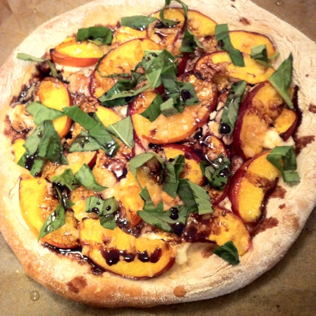 Peach Pizza w. basil & balsamic. Topped with Moody Blue Cheese.