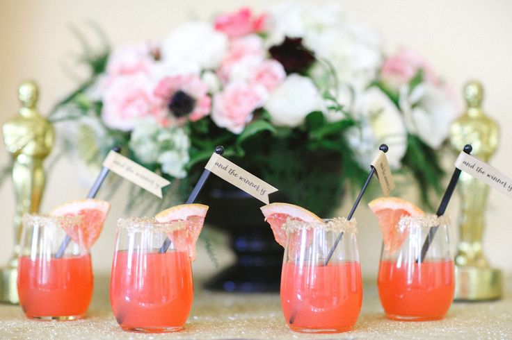 Instead of buying out the liquor aisle, focus on a single cocktail to serve guests, like Katie's grapefruit and tequila drinks.   Photo by A Girl and a Camera for Katie Rebecca Events