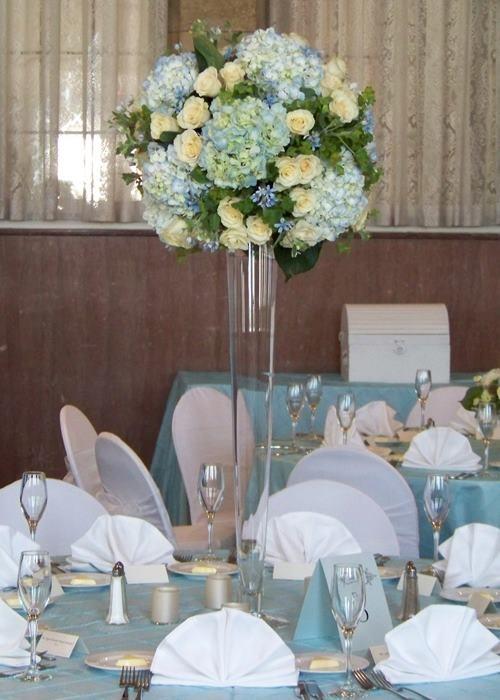 Centerpieces in pilsner vases wedding decor pinterest