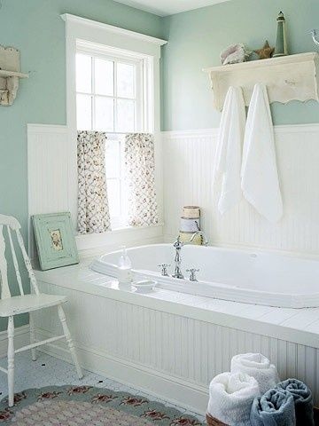 A pretty bathroom in seafoam green and whites. Per