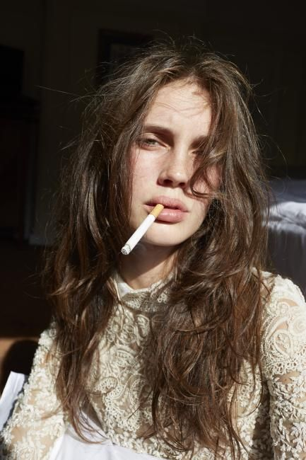 Marine Vacth smoking a cigarette (or weed)