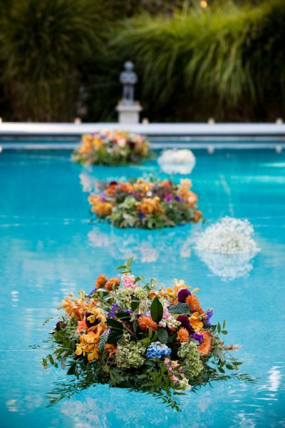 Floating arrangements wedding ideas pinterest for Flowers around swimming pool
