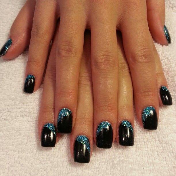 Black gel polish with blue glitter