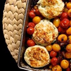 OMG - this sounds amazing! Tomato Cobbler With Blue Cheese Biscuits