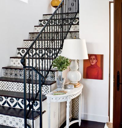 decorative tile on stairs. perfect match for the iron banister