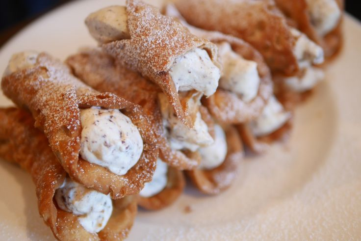 Homemade Cannoli stuffed with cream, ricotta and minted chocolate.