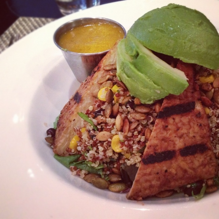 ... quinoa, corn, black beans, pumpkin seeds, and greens topped with