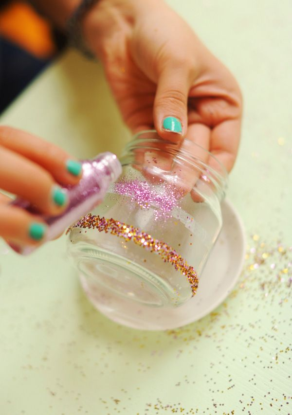 Use double-sided tape to make quick glittered candle holders.